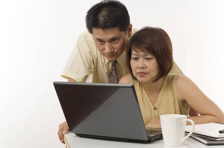 Asian couple at home using computer Stock Photo - 7510364