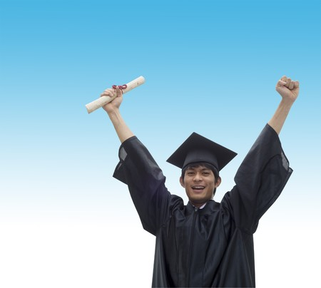 Young man with graduation cap and gown and diploma Stock Photo
