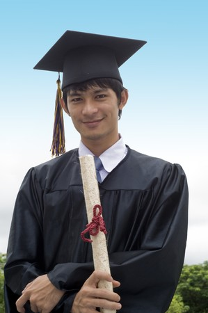 Young man with graduation cap and gown and diploma Stock Photo - 7510368