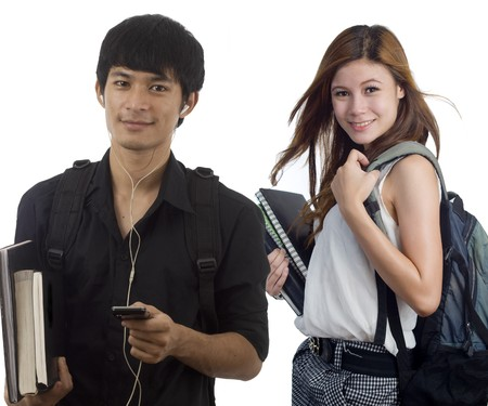 Young attractive male and female Asian students holding school books