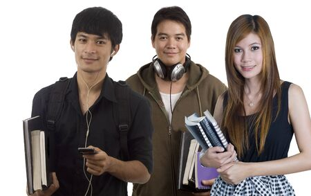 Young attractive male and female Asian students holding school books photo