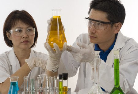 Scientists examining chemicals in a laboratory Stock Photo