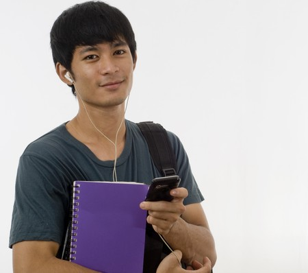 Asian teenage student with books and mobile telephone