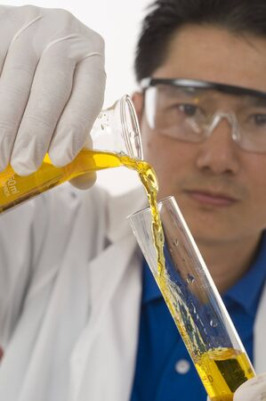 biomedical research: Scientist pouring chemicals in a laboratory