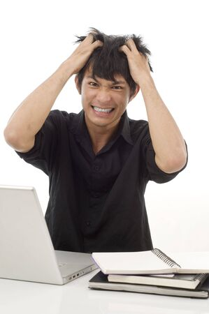Asian teenage student pulling his hair out from frustration photo
