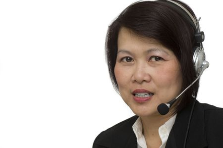 Attractive Asian business woman wearing headset and smiling Stock Photo - 7748692