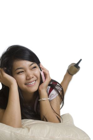 Attractive young Asian girl talking on the telephone Stock Photo - 7941259