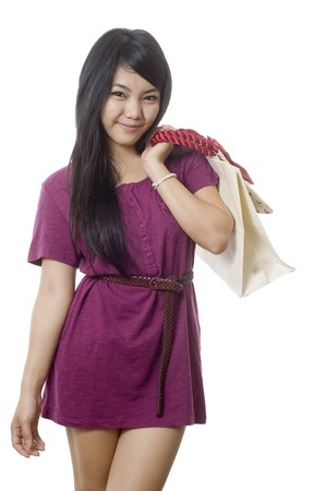 gift spending: Young attractive Asian woman with shopping bags