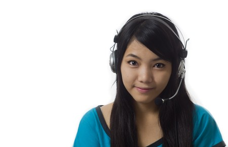 Attractive Asian business woman wearing headset and smiling photo