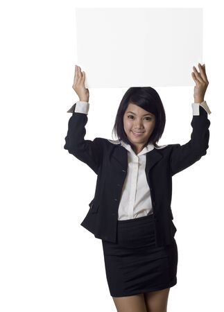 Woman showing and holding up over her head a blank billboard sign banner Stock Photo - 8094321