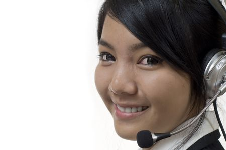 IT support: Attractive Asian business woman wearing headset and smiling
