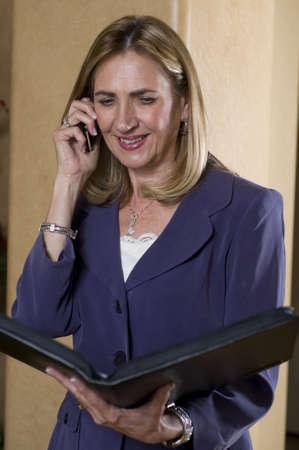 Mature businesswoman talking on mobile telephone photo