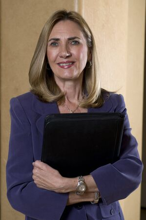 Portrait of a mature businesswoman holding her briefcase photo