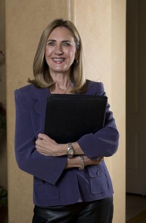 Businesswoman holding file folder photo