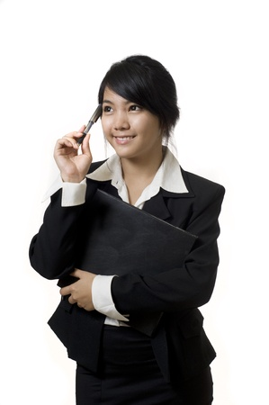 Portrait of a young attractive Asian business woman thinking photo