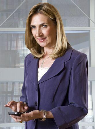 Mature woman using smartphone Stock Photo - 8793554
