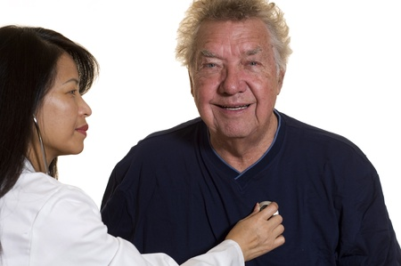 Elderly male patient getting check up from female Nurse Stock Photo - 8793550