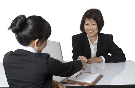 Portrait of Asian businesswoman shaking hands with colleague Stock Photo - 8896206