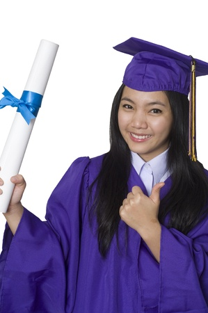 Young woman with graduation cap and gown Stock Photo - 8896213