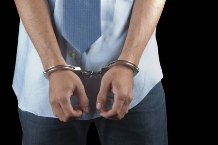 Handcuffs on a man who is arrested Stock Photo - 9292194
