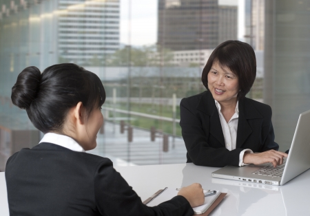 Two women having a business meeting photo