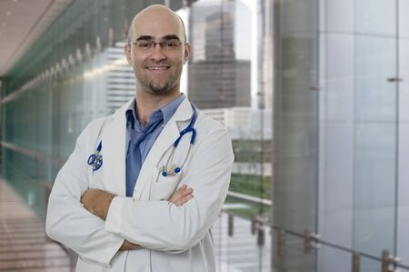 Smiling and confident Doctor standing with arms crossed photo