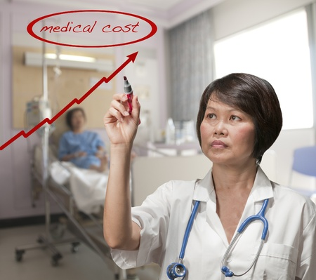 Doctor with patient in hospital room Stock Photo - 12789299