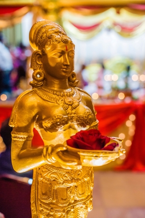 vedic: Gold Statue Decoration at Indian Wedding