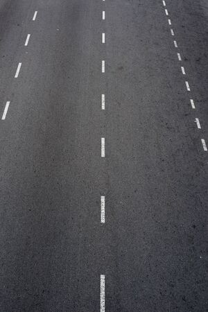 Asphalt road with white lines photo