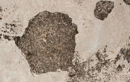 Grunge textured concrete sidewalk with big crack photo