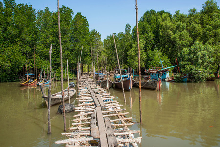 Small wooden bridge in local marina in Krabi photo