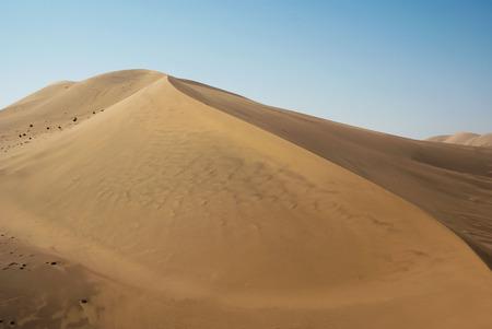 Sand dune in the Gobi desert near Dunhuang, China photo