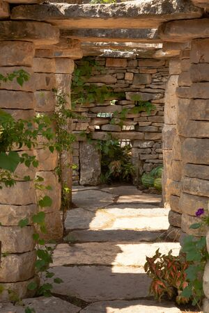 colonade: historical colonnade and a patio with stone columns Stock Photo