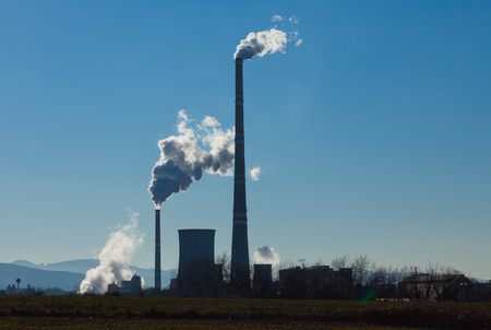 smokestacks: factory smokestacks with blue sky background