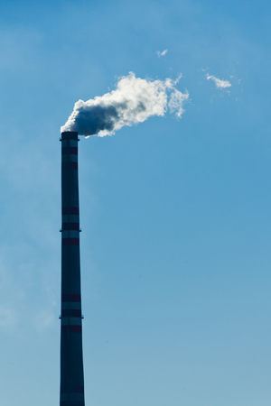 bluster: smoked industrial chimney with blue sky background