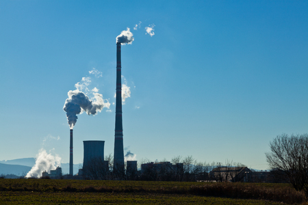 bluster: factory smokestacks with blue sky background
