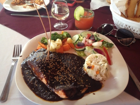Pink Salmon with Mole Salted and Peppered Vapored Vegetables Green Salad Mashed Potatoes with Bacon Tequila and Sangrita 版權商用圖片