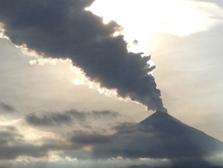 active volcano: Long column of ashes from an active volcano. Popocatepetl Mexico Stock Photo