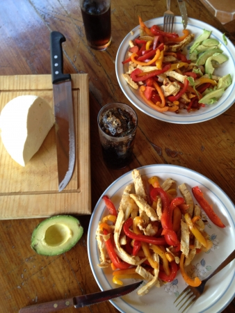 panela: Grilled Chicken Fajita Fiesta. Grilled chicken fajitas marinated with tabasco sauce and grilled with red orange and yellow peppers. Accompanied with avocado and fresh cheese.