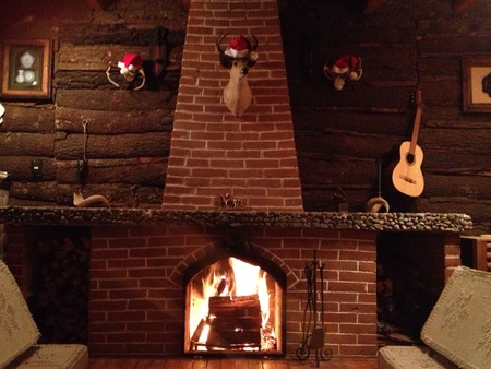 Light up christmas seasonal fireplace on a sunday night. Stock Photo - 20828197