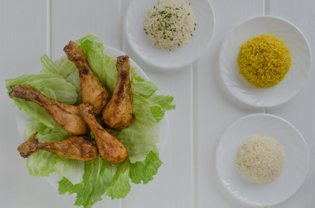 Grilled chicken thighs with with three rice on white wood photo