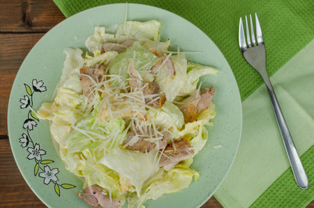 parmezan: Caesar salad with parmezan on nice plate, ready to eat