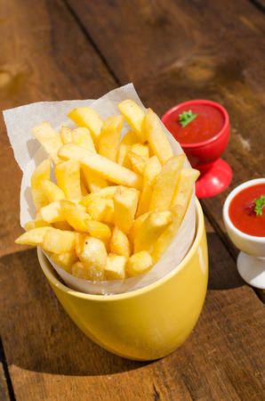 Golden French fries potatoes, ready to serve photo