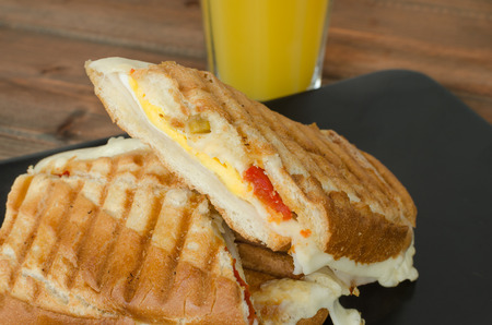 italien: Panini sandwiches italien with paprica, cheese, eggs and ham