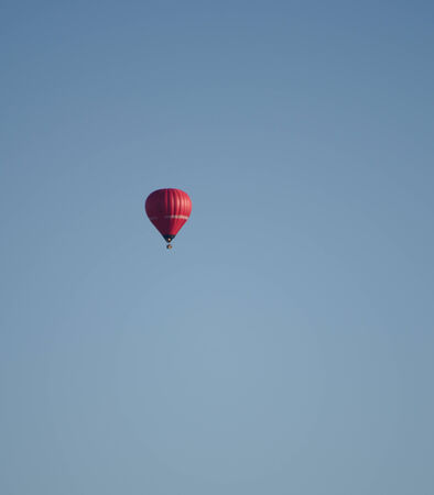 Blue sky and hot air balloon - red one photo