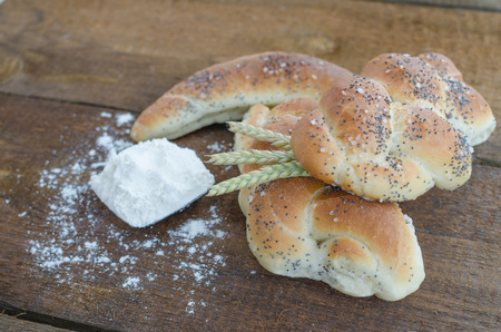 Bread roll and bun from small bakery with wheat photo