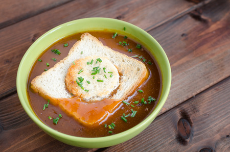 sausage pot: Goulash soup with fresh herbs and toast