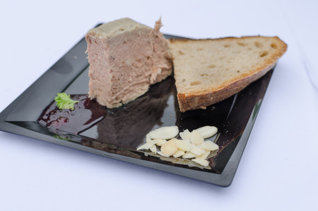 18th century: Duck pate with sauce of black berries and cranberries, rye bread recipe from the 18th century. Stock Photo