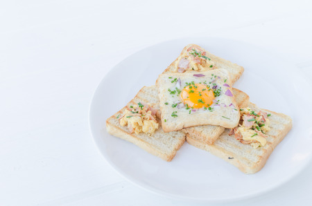 Fried egg inside toast with chive, ham and scrambled eggs photo