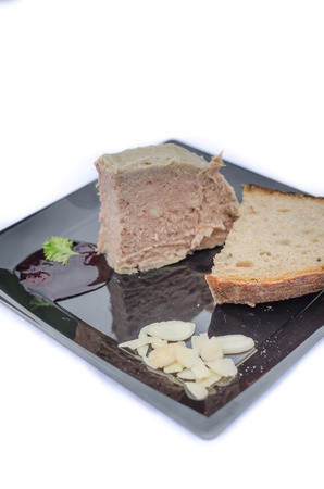 18th: Duck pate with sauce of black berries and cranberries, rye bread recipe from the 18th century. Stock Photo